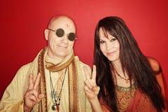 Hippies avec le signe de paix Photos stock