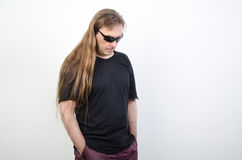 Hippies with long hair. A man in a black shirt Royalty Free Stock Photos