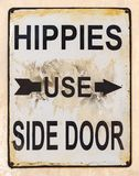 Hippies Use Side Door Sign. With arrow Stock Photos