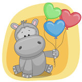 Hippo with balloons Royalty Free Stock Photos