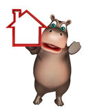 Hippo cartoon character  with home sign Royalty Free Stock Photos
