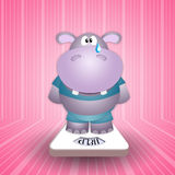 Hippo crying on the scale Royalty Free Stock Photos