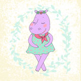 Hippo girl with closed eyes having a flower wreath on the head. Hippo girl with closed eyes having flower in her hand and a flower wreath on the head. Lovely Stock Photo