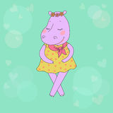 Hippo girl with closed eyes having a flower wreath on the head. Lovely hippopotamus in a dress in peas. Cute cartoon hippo sticker on blue background with Stock Photo