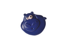 Hippo Hand Made. A homemade plastic brooch of blue in the form of a small hippo with big eyes on a white background Stock Photos
