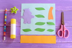 Hippo, leaves, palm tree trunk cut from colored paper. Set for children craft projects. Paper card hippo craft Stock Images