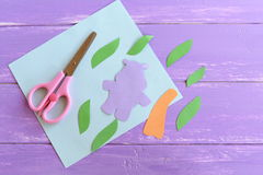 Hippo, leaves, palm tree trunk cut from colored paper. Set to create a summer children cards. Scissors, paper sheet Royalty Free Stock Image