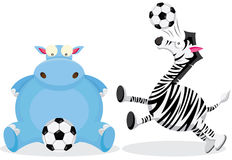Hippo and Zebra play with Soccer Ball Royalty Free Stock Photos