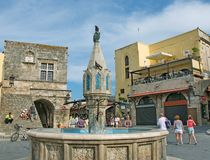 Hippocrates square with fountain in medieval Old Town of Rhodes Royalty Free Stock Photography