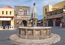 Hippocrates square with fountain in medieval Old Town of Rhodes stock photo