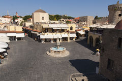 Hippocrates square in the historic Old Town of Rhodes Greece. Medieval fountain Hippocrates square in historic Old Town of Rhodes Greece photo Stock Photos