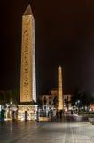 Hippodrome (At Meydani) - Thutmosis' and Walled Obelisk. Thutmosis' and Walled Obelisk at Hippodrome (At Meydani) at night - Istanbul Stock Photos