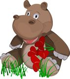 Hippopotamus. Cheerful hippo with a bouquet of flowers in the form of heart. Picture of Valentine's Day Royalty Free Stock Photo