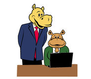 Hippos in office 4. Two hippos in office at a desk with a laptop Royalty Free Stock Image