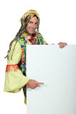 Hippy. Pointing to a blank advertising board Stock Photography