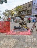 Hippy che vende la sua arte sulla città di Londrina Immagine Stock