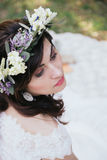 Hippy and chic bride portrait. With flower crown and earrings Royalty Free Stock Photos