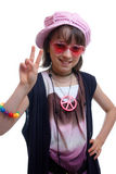 Hippy Chick. Young girl dressed in 60's style as a hippie Stock Photography