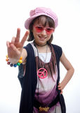 Hippy Chick. Girl dressed as a hippie chick gibing the peace sign Stock Image