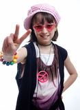 Hippy Chick. Young girl giving the peace sign Stock Images