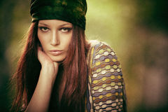Hippy girl. Woman in hippy style clothes outdoor portrait, small amount of grain added Stock Photo