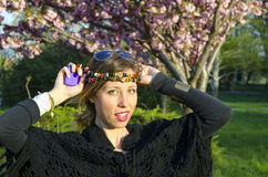 Hippy girl with colorful necklaces around her head Royalty Free Stock Photos