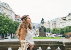 Hippy-looking woman tourist enjoying sightseeing in Prague Royalty Free Stock Photography