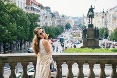 Hippy-looking woman tourist standing on Wenceslas Square, Prague Stock Photo
