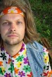 Hippy portrait. Young hippie man portrait with guitar Stock Images