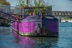 Hippy purple house boat Peniche in Paris royalty free stock images