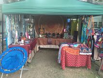 Hippy shop. Hippy vendor at a festival selling tie dye Stock Images