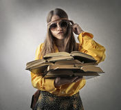 Hippy studying. Hippy teenager reading some books Royalty Free Stock Photo