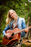 Hippy Woman with Guitar Royalty Free Stock Image