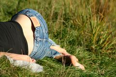 Hips. Lady sleeping in blue jeans Stock Photo