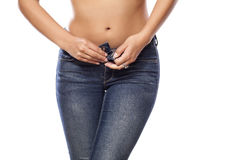 Hips in jeans Stock Images
