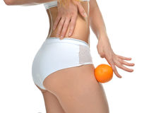 Hips legs buttocks and orange in hand cellulite liposuction woma Stock Photo