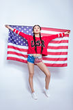Hipster asian girl in sweatshirt with USA word holding american flag isolated on grey. 4th july - Independence Day Royalty Free Stock Photo