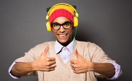Hipster asian man in earphones Stock Images