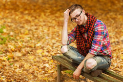 Hipster in the autumn park Royalty Free Stock Photography