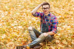 Hipster in the autumn park Royalty Free Stock Image