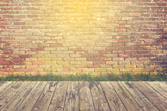 Hipster background with wooden deck floor and brick wall. Hipster background with wooden deck floor, grass and brick wall stock images