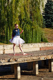 Hipster Ballerina dancing in autumn park. Stock Photos