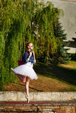 Hipster Ballerina dancing in autumn park. Stock Photography