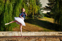 Hipster Ballerina dancing in autumn park. Stock Images