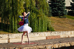 Hipster Ballerina dancing in autumn park. Royalty Free Stock Images