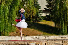 Hipster Ballerina dancing in autumn park. Stock Photo