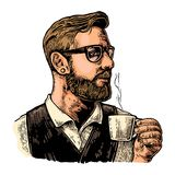 Hipster barista with the beard holding a cup of hot coffee. Royalty Free Stock Photos