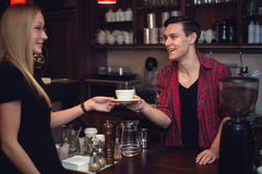 Hipster barista pass order cup of coffee or tea Royalty Free Stock Photos