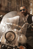 Hipster Bearded Biker Man Sitting on a Motorcycle Royalty Free Stock Photos