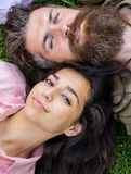 Hipster bearded man and girl happy carefree enjoy relax. Man unshaven and girl lay near top view. Feminine and masculine royalty free stock image
